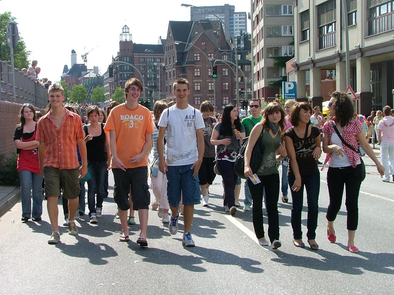 Students walk down the street of a town or city