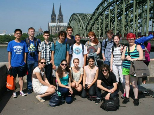Students gether for a photo near Cologne bridge with the cathedral in the background